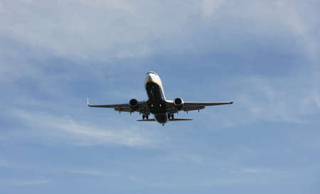 Airliner Makes its Landing Approach with a blue sky photo