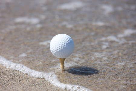 golf ball in the beach photo