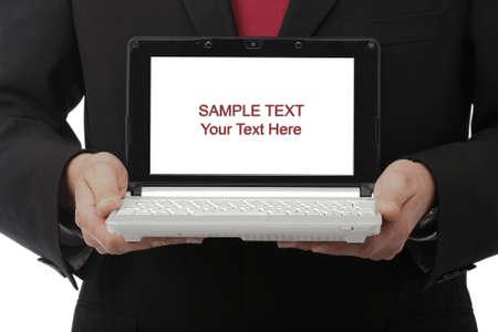 Businessman holding his laptop Standard-Bild