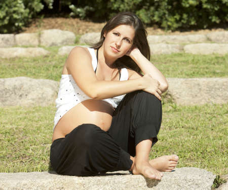 Beautiful pregnant woman relaxing in the park Stock Photo - 8093483