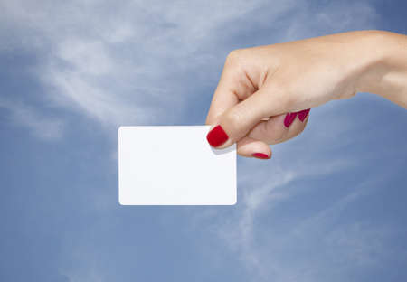 Hand holding an empty business card with a blue sky background Stock Photo - 8253785