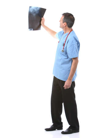 doctor looking at a xray in a white background Stock Photo