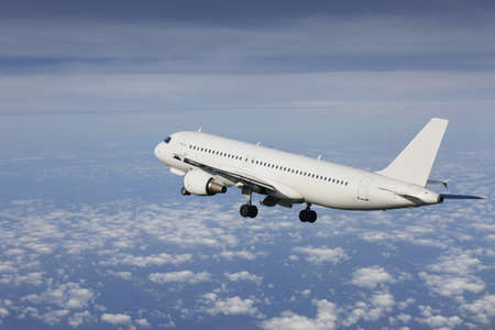 airliner taking off in a cloudy saky Stock Photo - 9214319
