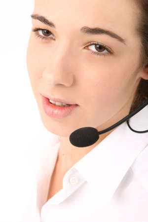 portrait of a young beautiful business woman using head phone photo