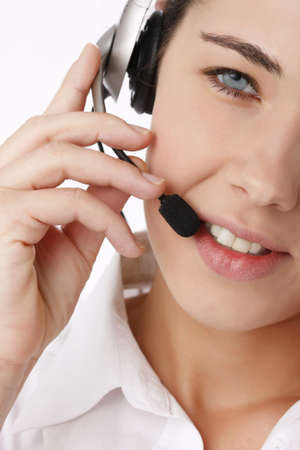 Close-up portrait of a young beautiful business woman using head phone photo