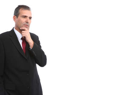 Portrait of handsome thoughtful businessman