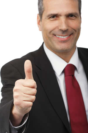 victory symbol: businessman showing thumbs-up sign - on white background - focus on the hand