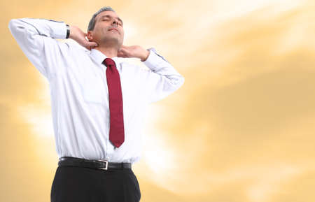 business man relaxing orange background