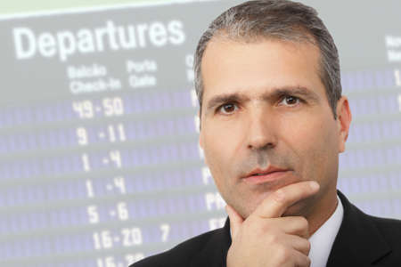 Portrait of handsome thoughtful businessman on airport Standard-Bild