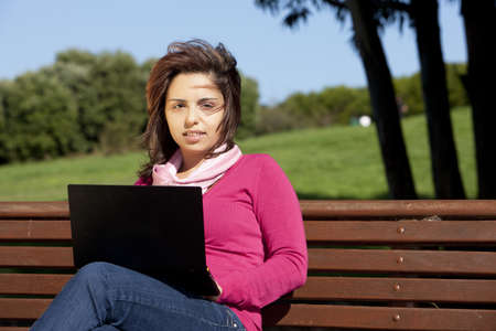 woman studying with a laptop in the park photo