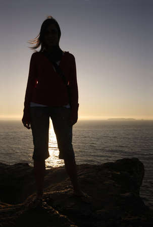 woman silhouette in th mountain at sunset