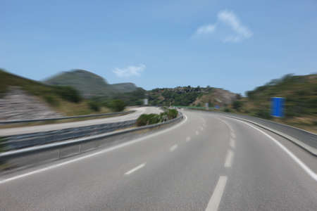 Mountain road curve with blue sky