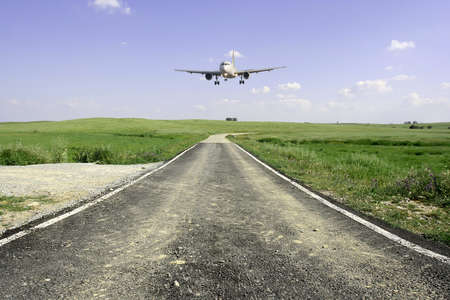 aircraft landing in a beautifull rural landscape photo