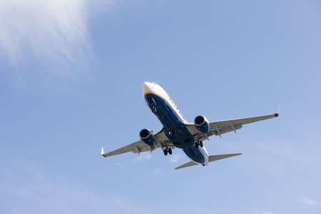 aircraft makes its landing approach to airport photo