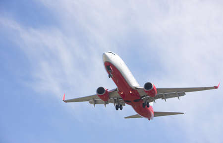airplane take off: aircraft makes its landing approach to airport