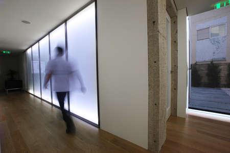 Businessman walking inside the office