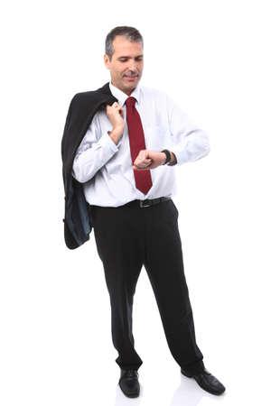 handsome businessman checking time on his watch Standard-Bild