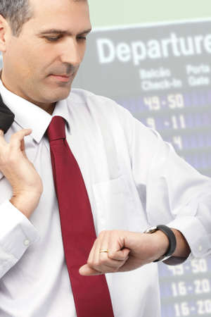 handsome businessman checking time on his watch photo