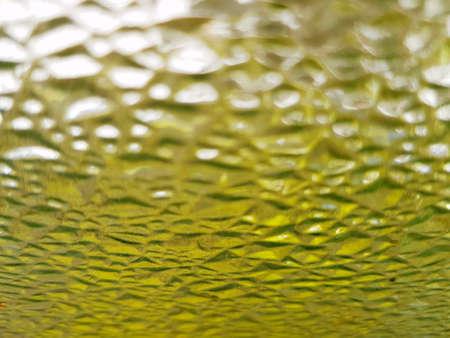 Gekorreld glas met gele kleur, vuile, gestructureerde achtergrond
