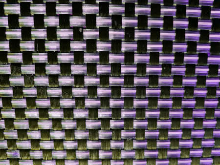 Mexican handcrafted design, plastic woven in purple and pink with black, textured background