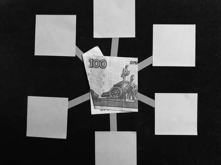idea of a mind map with a Russian banknote of 100 rubles in the center, black and white image