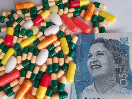 Colombian banknote of 2000 pesos, capsules and medicine pills