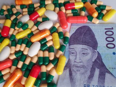 South Korean banknote of 1000 won, capsules and medicine pills