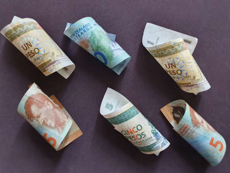 Cuban bills and New Zealand banknotes of different denominations