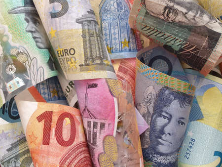 approach to australian banknotes and european bills of different denominations 版權商用圖片