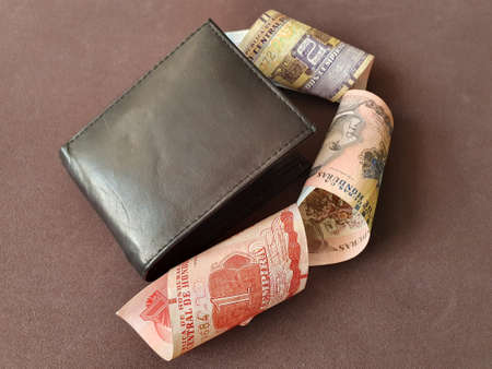 black leather wallet and honduran banknotes of different denominations