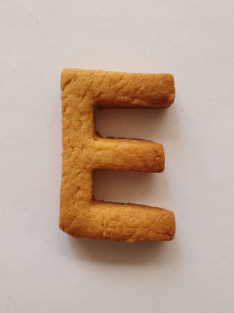 baked biscuit with shape the letter E Stockfoto