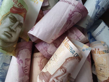 approach to peruvian banknotes and brazilian money Stockfoto
