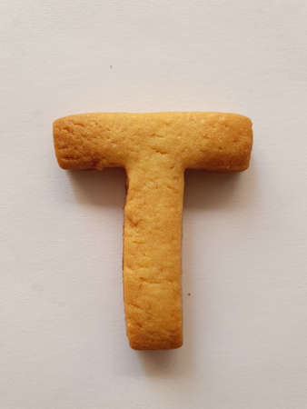 baked biscuit with shape the letter T Stockfoto