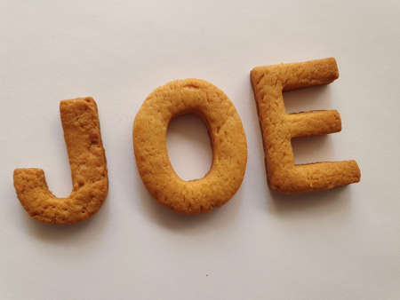 baked biscuits with shape of letters forming the name Joe Stockfoto