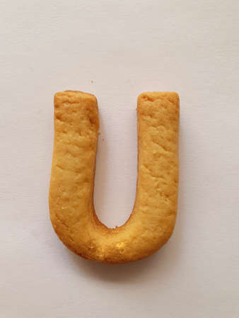 baked biscuit with shape the letter U