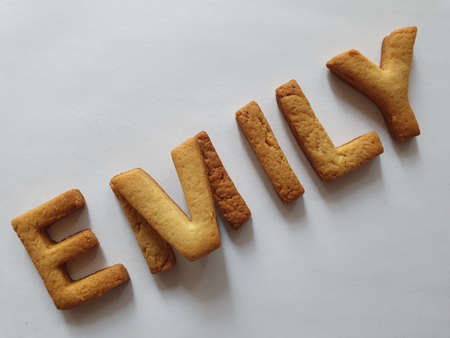 baked biscuits with shape of letters forming the name Emily Stockfoto