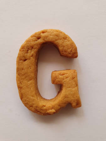 baked biscuit with shape the letter G