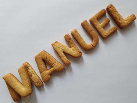 baked biscuits with shape of letters forming the name Manuel
