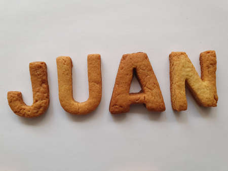baked biscuits with shape of letters forming the name Juan Stockfoto