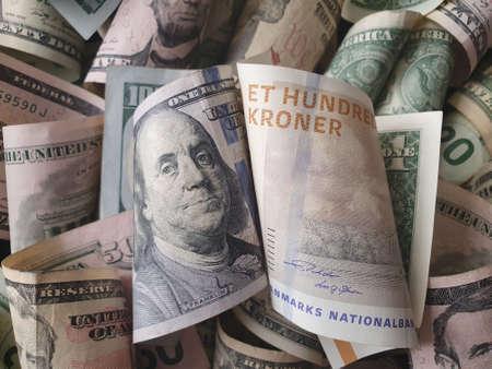 danish banknote of 100 kroner and American dollar money