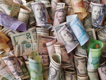 nicaraguan banknotes and american dollar bills of different denominations