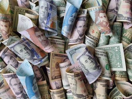 colombian banknotes and american dollar bills of different denominations