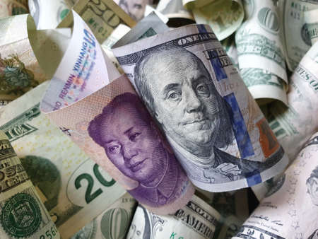 approach to Chinese banknote of five yuan and american dollar money