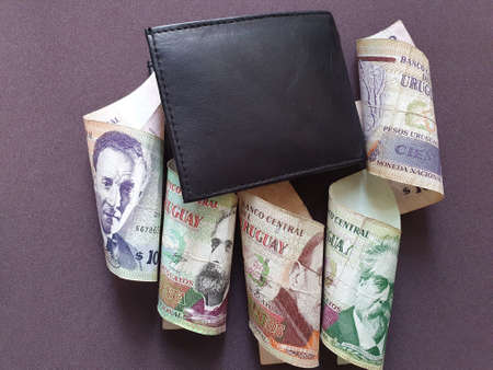 black leather wallet and uruguayan banknotes of different denominations Stockfoto