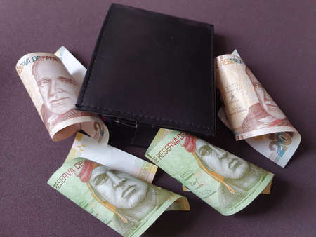 black leather wallet and peruvian banknotes of different denominations