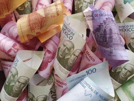 approach to nicaraguan banknotes and mexican bills of different denominations