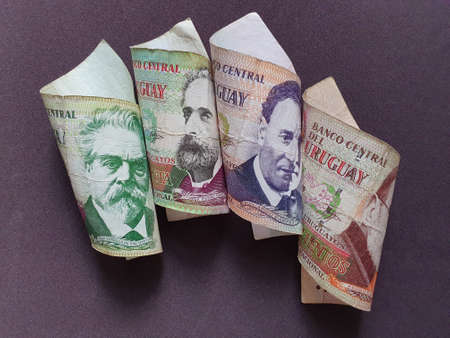 uruguayan banknotes of different denominations and brown background Stockfoto