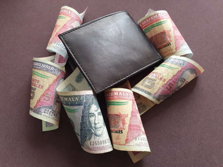black leather wallet and guatemalan banknotes of different denominations Stockfoto
