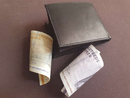 black leather wallet and Danish banknotes of different denominations