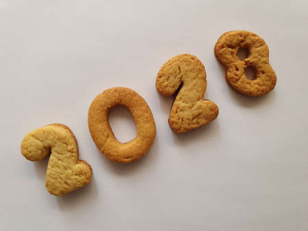 baked biscuit that form the number 2028, background for celebration and events Stockfoto